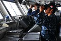 US Navy 110531-N-EE987-006 Ensign Claudia Garcasrios and Operations Specialist Seaman David Gomez scan for surface contacts on the bridge of USS Ro.jpg
