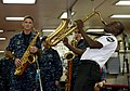 US Navy 110829-N-RM525-138 A Haitian Police Band member plays the saxophone with U.S. Fleet Forces Band aboard USNS Comfort (T-AH 20) during Contin.jpg