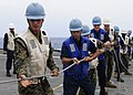 US Navy 111003-N-WJ771-086 Sailors and Marines assigned to the forward-deployed amphibious transport dock ship USS Denver (LPD 9) heave around on a.jpg