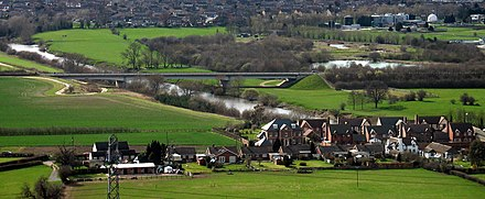 The Severn bridged by the A49 road just outside Shrewsbury. The village of Uffington, Shropshire is in the foreground. UffingtonShropshire.JPG