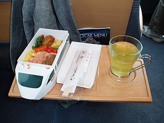 Romancecar - Bento meal with food in model train onboard VSE train