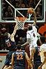 VT - UVA 2012 - Caradian Raines takes a shot as Joe Harris attempts to block.jpg