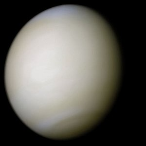 Venus - A real-colour image of Venus taken by Mariner 10 processed from two filters. The surface is obscured by thick sulfuric acid clouds.