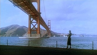 "Vertigo (film) - ""Madeleine"" at Golden Gate Bridge, Fort Point, shortly before she jumps into the bay."