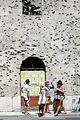 Visitors Stand in Front of War-Damaged Facade - Mostar - Bosnia and Herzegovina.jpg