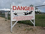 Warning Sign at Maho Beach (6544018565).jpg