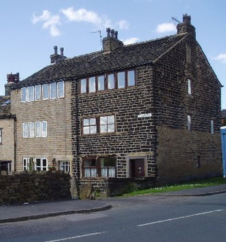 Greater Manchester - Former weavers' cottages in Wardle. The development of Greater Manchester is attributed to a shared tradition of domestic cloth production, and textile manufacture during the Industrial Revolution.