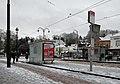 Wiener STIB tram stop on a snowy day in December (Watermael-Boitsfort, Belgium).jpg