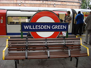 Willesden Green tube station, roundel and bench
