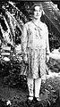 Woman posed in a garden (3525681979).jpg