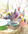 Women fetching water from a well in Northern Ghana.jpg
