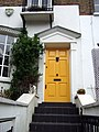 Yellow door with flowers and cat - geograph.org.uk - 1276974.jpg