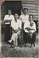 - Tambukau, his wives and brother, Kwijau, Keningau (7930176232).jpg