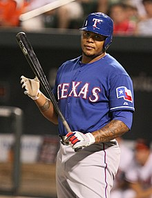 Andruw Jones in a Texas Rangers uniform readying for an at-bat