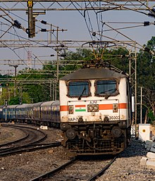 Light-coloured electric locomotive