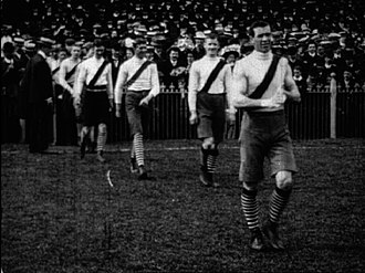 1909 VFL Grand Final - Still image taken from footage of the 1909 VFL Grand Final. South Melbourne players enter the field before the game.