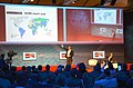 2014-03-14 CeBIT Global Conferences, Jimmy Wales, Founder Wikipedia, (26) On stage showing the world for Wikipedia Zero (500 millions), while Brent Goff is still listening.jpg