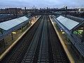 2015-04-09 06 31 42 View northeast along the Northeast Corridor rail line from the pedestrian overpass at the Newark Liberty International Airport Train Station, New Jersey.jpg
