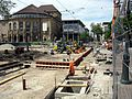 2016-05-22, Gleiserneuerung in der Bertoldstraße in Freiburg, im Hintergrund das Stadttheater.jpg