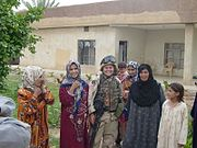 2BDE 1ID Iraq 2004 SPC Buckner with iraqi women