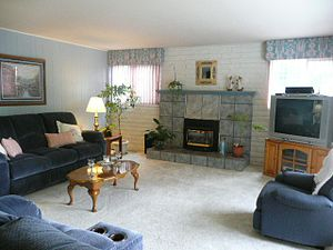 English: Spacious Living room with gas firepla...