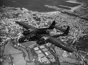 "Maupertus-sur-Mer Airfield - A P-61 Black Widow (serial number 42-5565) nicknamed ""Double Trouble"" of the 422nd Night Fighter Squadron over Cherbourg, France"