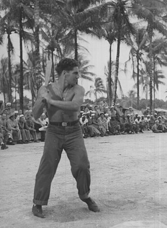 Phil Rizzuto - Rizzuto at bat in front of a group of US Navy Sailors in the South Pacific during his time in the US Navy between 1943 and 1945.