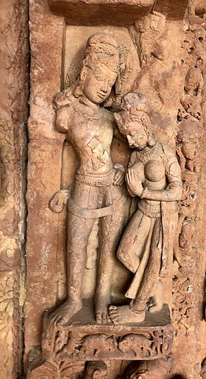Sirpur Group of Monuments - Sirpur relief excavated: she steps on his feet, seeks forgiveness with a namaste gesture.