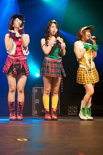 Music industry - Japanese idol music band AKB48 entertain the audience by performing on stage in Paris, France, 2009