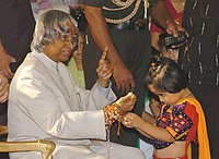 A girl tying Rakhi to the President Dr. A. P. J. Abdul Kalam.jpg