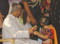 A girl tying Rakhi to the President Dr. A. P. J. Abdul Kalam.jpg
