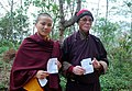 A nun and a monk showing mark of indelible ink after casting their votes during the 4th Phase of Lok Sabha General Elections-2014, in Sikkim on April 12, 2014.jpg