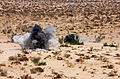A simulated improvised explosive device detonates during a convoy exercise conducted by U.S. Marines with Combat Logistics Battalion 6, 2nd Marine Logistics Group at Marine Corps Air Ground Combat Center 130522-M-ZB219-005.jpg