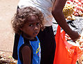 A small boy at the market with his mother. (10663230374).jpg