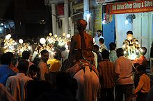 A wedding procession with the bridegroom on a horse, Pushkar, Rajasthan