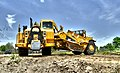 A wheel tractor-scraper attempts a u-turn during levee work April 30, 2012 (6989951494).jpg