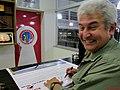 """Academia da Força Aérea (AFA) em Pirassununga-SP-Brasil. O primeiro astronauta brasileiro, Marcos Pontes dando um autógrafo em um banner no Domingo Aéreo 2015 no """"Ninho das Águias"""", no - panoramio.jpg"""