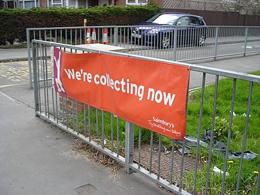 A Sainsbury's Active Kids banner outside a school. Tokens are collected at supermarkets and are redeemed for sports equipment. Active Kids.JPG