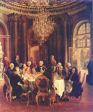 Die Tafelrunde by Adolph von Menzel.  Guests of Frederick the Great, in Marble Hall at Sanssouci, include members of the Prussian Academy of Sciences and Voltaire (seated, third from left).