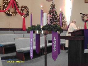 Antependium - Paraments hanging from an Advent wreath in a Methodist church.