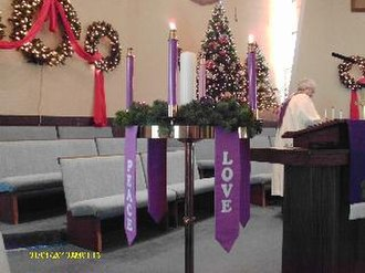 Parament - Paraments hanging from an Advent wreath in a Methodist church.