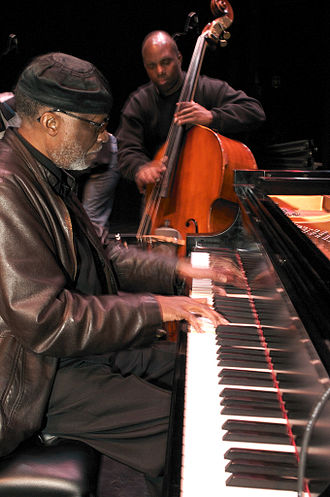 James Cammack - James Cammack plays double bass with pianist Ahmad Jamal in the foreground.