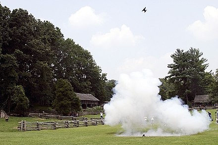 "An anvil is blown sky-high during an ""anvil shoot"" at the museum's July 4th celebration."