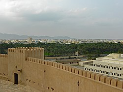 View of the city from Rustaq Fort, with the Western Hajar Mountains in the background