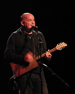 Alain Johannes - Johannes playing his cigar box guitar in a performance in Seattle, November 9, 2010