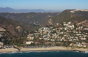 Aliso Creek (Orange County) - Aerial view of the mouth of Aliso Creek, Aliso Beach is in foreground, Aliso Canyon behind. The Pacific Coast Highway crosses the creek just above its mouth.
