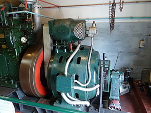 Excitation (magnetic) - Alternator of 1930s diesel generating set, with excitation dynamo above