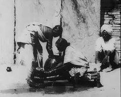 Податотека:An Indian Washing the Baby, 1906.webm