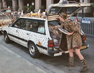 "Art car - ""Animal print"" art car Leopard Bernstein, with owner/creator Kelly Lyles dressed in matching motif."