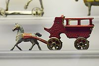 Antique toy horse-drawn carriage (25597954664).jpg